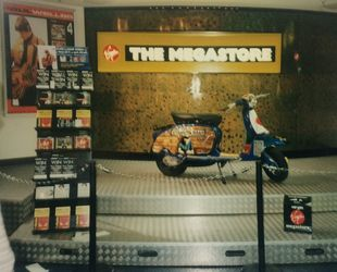 The prize SX on display inside the store