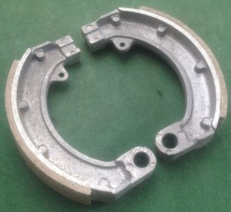 Vespa 90SS ET3 Primavera 50S rear brake shoes N.O.S image #1