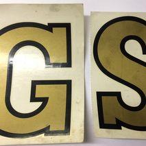 """Gold """"GS"""" legshield Decorettes 5"""" (127 mm)"""
